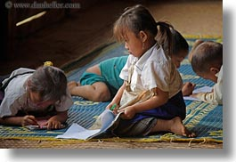 asia, buildings, class, classroom, girls, hmong, horizontal, laos, school, structures, villages, working, photograph