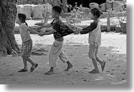asia, asian, black and white, childrens, horizontal, laos, people, pulling, river village, shirts, villages, photograph