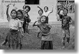 asia, asian, black and white, childrens, emotions, horizontal, laos, laugh, people, river village, running, smiles, villages, waving, photograph