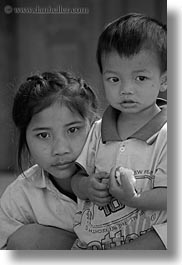 asia, asian, black and white, boys, girls, laos, people, river village, shirts, vertical, villages, yellow, photograph