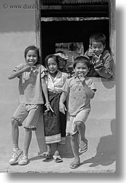 asia, asian, black and white, childrens, emotions, laos, laugh, people, playing, river village, smiles, vertical, villages, windows, photograph