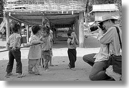 asia, asian, black and white, cameras, clothes, emotions, hats, horizontal, laos, laugh, men, people, photographing, river village, smiles, toddlers, tourists, villages, photograph