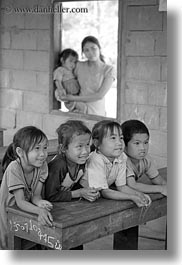 asia, asian, black and white, childrens, desks, emotions, laos, people, poverty, river village, school, smiles, vertical, villages, photograph