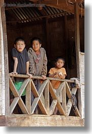 asia, asian, balconies, boys, emotions, laos, people, river village, smiles, vertical, villages, photograph