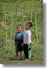 asia, asian, boys, emotions, fields, laos, people, river village, smiles, vertical, villages, young, photograph