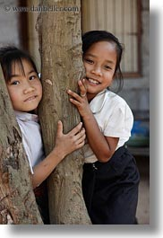 asia, asian, emotions, girls, laos, people, river village, smiles, trees, vertical, villages, photograph