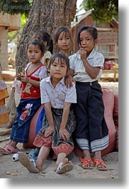 asia, asian, emotions, girls, groups, laos, people, river village, smiles, vertical, villages, photograph