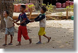 asia, asian, childrens, emotions, groups, horizontal, laos, people, pulling, river village, shirts, smiles, villages, photograph