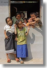 asia, asian, childrens, emotions, groups, laos, laugh, people, playing, river village, smiles, vertical, villages, windows, photograph