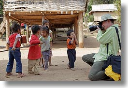 asia, asian, cameras, clothes, emotions, groups, hats, horizontal, laos, laugh, men, people, photographing, river village, smiles, toddlers, tourists, villages, photograph