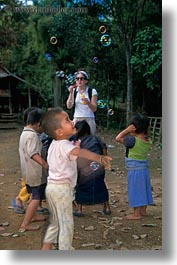 asia, asian, bubbles, childrens, emotions, laos, people, playing, poverty, river village, smiles, vertical, villages, photograph