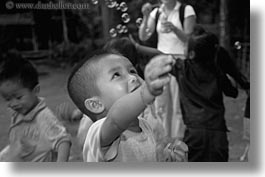 asia, asian, black and white, bubbles, childrens, emotions, horizontal, laos, people, playing, poverty, river village, smiles, villages, photograph