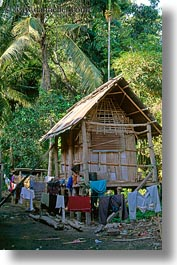 asia, huts, laos, poverty, river village, roofs, thatched, vertical, villages, photograph