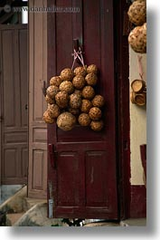 asia, balls, doors, laos, river village, vertical, villages, wicker, photograph