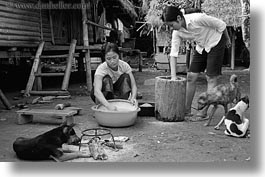 animals, asia, asian, black and white, clothes, dogs, horizontal, laos, people, poverty, river village, villages, washing, womens, photograph