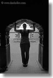 archways, asia, black and white, kathmandu, museums, nepal, silhouettes, under, vertical, womens, photograph