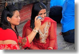 asia, emotions, friends, girls, horizontal, kathmandu, nepal, pashupatinath, people, photographing, smiles, teenagers, womens, photograph