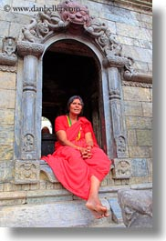 archways, asia, bindi, hindu, jewelry, kathmandu, nepal, pashupatinath, religious, sindoor, sitting, tikka, under, vertical, womens, photograph