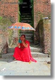 asia, bindi, earrings, hindu, jewelry, kathmandu, nepal, pashupatinath, religious, sindoor, stud, tikka, umbrellas, vertical, womens, photograph