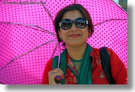 asia, bindi, emotions, hindu, horizontal, jewelry, kathmandu, nepal, pashupatinath, people, religious, sindoor, smiles, tikka, tour guides, umbrellas, womens, photograph