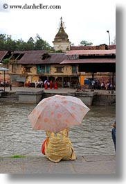 asia, kathmandu, nepal, pashupatinath, rivers, umbrellas, vertical, womens, photograph
