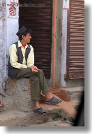 asia, kathmandu, men, nepal, patan darbur square, sitting, vertical, photograph