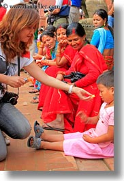 asia, childrens, emotions, feeding, kathmandu, nepal, patan darbur square, photographers, smiles, vertical, womens, photograph