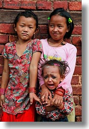 asia, babies, crying, emotions, girls, kathmandu, nepal, patan darbur square, smiles, smiling, vertical, womens, photograph