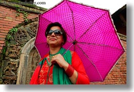 asia, emotions, guides, horizontal, kathmandu, nepal, patan darbur square, smiles, tours, umbrellas, womens, photograph