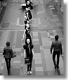 asia, black and white, buildings, mannequins, moscow, pedestrians, russia, rym shopping mall, vertical, photograph