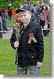 asia, baseball cap, boys, childrens, clothes, flowers, hats, moscow, nature, people, posing, russia, tulips, vertical, photograph