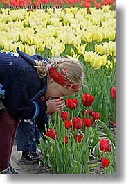 asia, childrens, colors, flowers, girls, moscow, nature, people, red, russia, smelling, tulips, vertical, yellow, photograph