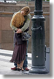 asia, couples, emotions, heads, hug, moscow, people, red, romantic, russia, vertical, photograph