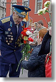 asia, boys, clothes, decorated, emotions, happy, hats, hero, men, moscow, people, russia, vertical, war, photograph
