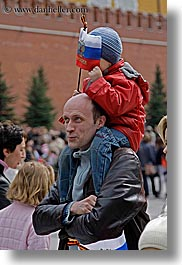 asia, clothes, emotions, fathers, flags, hats, humor, men, moscow, people, russia, shoulders, sons, vertical, photograph