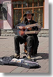 artists, asia, beards, clothes, double, emotions, guitars, hats, instruments, men, moscow, music, musicians, neck, people, playing, russia, serious, vertical, photograph