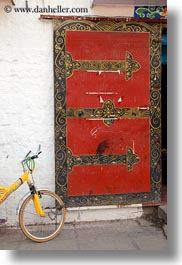 asia, asian, bicycles, colors, doors, lhasa, red, style, tibet, vertical, photograph