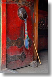 asia, asian, cloths, colors, doors, lhasa, red, ropes, style, tibet, vertical, woods, photograph