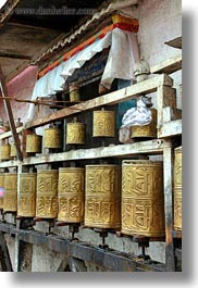 asia, buddhist, golden, lhasa, prayers, religious, spinning, temples, tibet, vertical, photograph