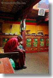 alone, asia, buddhist, lhasa, men, monks, people, religious, rooms, sitting, tibet, vertical, photograph