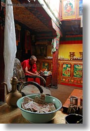 alone, asia, buddhist, cash, lhasa, men, money, monks, people, religious, rooms, sitting, tibet, vertical, photograph