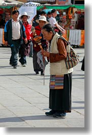 asia, buddhist, lhasa, old, people, praying, religious, tibet, vertical, womens, photograph