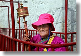 asia, buddhist, horizontal, lhasa, old, people, poles, prayers, religious, tibet, womens, photograph