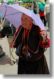asia, emotions, lhasa, old, people, purple, smiles, tibet, umbrellas, vertical, womens, photograph
