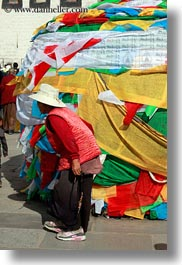 asia, buddhist, flags, lhasa, old, people, prayer flags, prayers, religious, tibet, vertical, walking, womens, photograph