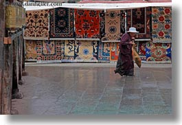 asia, horizontal, lhasa, old, people, rugs, tibet, walking, womens, photograph