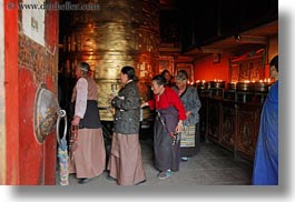 asia, buddhist, glow, horizontal, lhasa, old, people, prayers, religious, temples, tibet, turbine, turning, womens, photograph