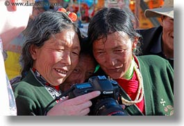 asia, cameras, emotions, horizontal, lhasa, looking, people, smiles, tibet, tibetan, womens, photograph