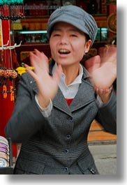 asia, hands, lhasa, people, tibet, vertical, waving, womens, photograph