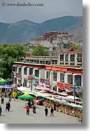 asia, lhasa, palace, people, potala, shops, streets, tibet, vertical, photograph